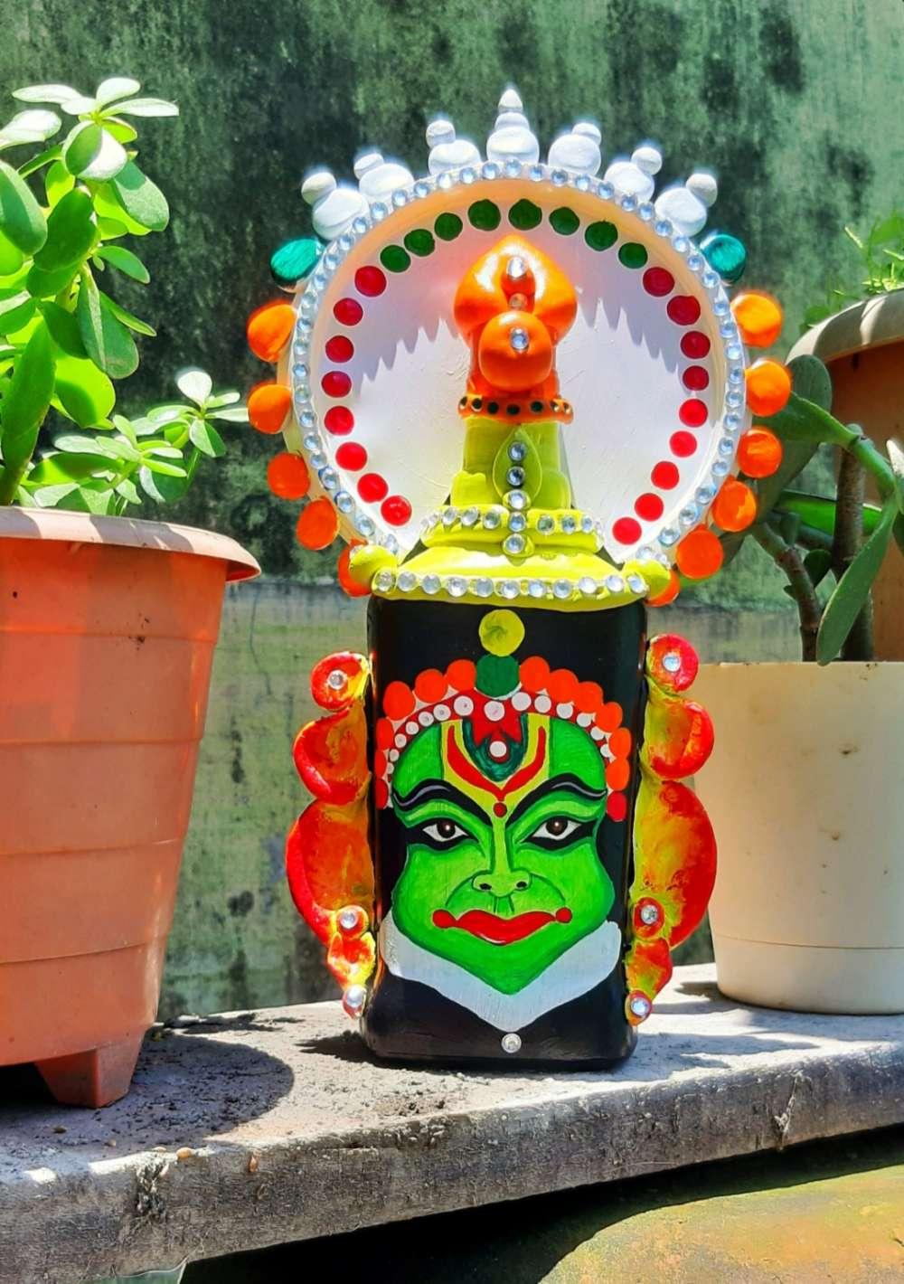 Glass bottle art kathakali face