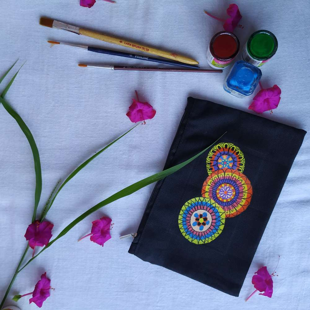 Hand-painted mandala art on pouch
