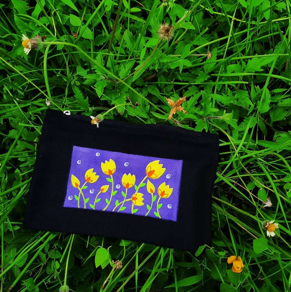 Hand-painted flower pattern art on pouch